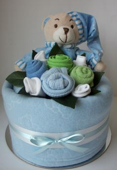 cute baby nappy cake from Addictive Gifts Baby Shower Diapers, Baby Shower Gifts, Baby Gifts, Baby Nappy Cakes, Diaper Cakes, New Baby Crafts, Gift Baskets For Women, Towel Cakes, New Baby Products
