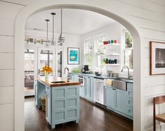 arched entry + pale blue cabinets