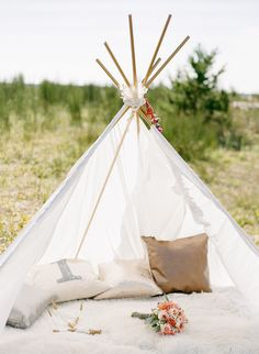 Engagement Shoot Setting | Teepee | Photography: Nadia Hung Photography | http://www.stylemepretty.com/canada-weddings/2013/11/11/bohemian-engagement-session-from-nadia-hung-photography