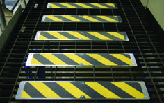 Aluminum Stair Tread - Black and Yellow in use
