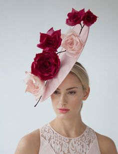 Handcrafted in our London studio. Sinamay hat with silk dupion handmade flowers. Colours: Pale Pink, Cerise. Secured with a comb and hairband. This hat is Made To Order. Sent free within the UK in a beautiful Black & White striped hatbox. If you have any questions, please get