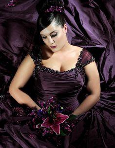 A beautiful Aubergine taffeta dress, stocked in sizes 18-32