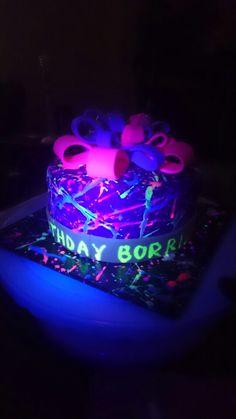Neon splatter cake glows under black lights