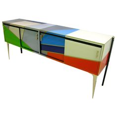 1980 One-of-a-Kind Italian Modern Colored Glass Sideboard with Sliding Doors | From a unique collection of antique and modern sideboards at https://www.1stdibs.com/furniture/storage-case-pieces/sideboards/