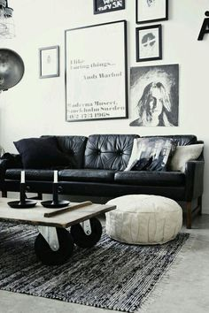 Add some character in your living space #monochrome features.  From paintings to candle holders an vintage coffee table