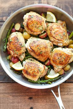Lemon Chicken with Asparagus and Potatoes —made in one skillet, lemon chicken with asparagus and potatoes is not only low-fuss but also extratasty by design, as the chicken juices baste the bed of vegetables as they roast, via @damndelicious