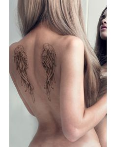 Been looking for a medium size tattoo like this. My favorite so far. But I would like s rose intertwined within the wing