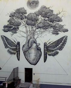 This mural looks a lot like a tattoo. Artist: Alex Diaz #streetart