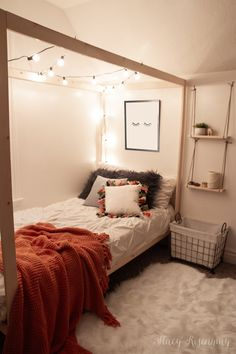 A canopy bed with string lights, hanging shelves, a faux fur rug, and pillows with tassels complete this fun teen girl's boho room! bedroom decor A Boho Room For My Niece - Stacy Risenmay Cute Room Ideas, Cute Room Decor, Diy Room Ideas, Sunroom Ideas, Bed Ideas, Wall Decor, Dream Rooms, Dream Bedroom, Master Bedroom