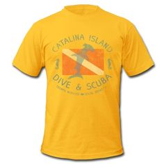 Catalina Island Dive and Scuba from SoCal Brand apparel features a vintage, worn and faded look on a unbelievably soft and comfortable t-shirt. The design features a hammerhead shark overlaid on a scuba diver's flag, flanked by sea horses with the title Catalina Island Dive