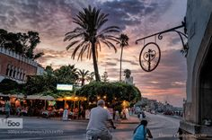 Walking in the town of the island by yiannischatzipanagiotis  Greek islands aegean sea bikes clouds colors greece island kos island sky summer sunset yiannischatz