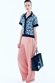 RESORT 2014 Rochas /  Having doubled down on ladylike for Fall, Marco Zanini returned to eccentricity for Resort. It's hard to imagine another designer with the temerity to work up a stretch-brocade gown with an allover crab motif. He rode the seaside vibe through oysters and rays, too, in prints on clothes and leather appliqués on accessories.