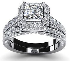$3,947  -  DOUBLE HALO BRIDAL SET * EGL CERTIFIED * PRINCESS CUT 2.85 CARATS ON 14K SOLID WHITE GOLD F 26 D http://www.amazon.com/dp/B00OU72PF2/ref=cm_sw_r_pi_dp_0TNyub0MXSQBD