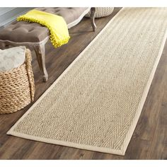 Dress up any space with this natural hand-woven rug made from seagrass with a cotton backing. The fringeless border on this rug gives it a clean look.