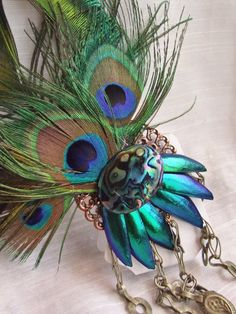 Kuchi Feather Fascinator- Electric Green with Beetle Wings, Peacock Feathers, Tribal Fusion, Mermaid. $32.00, via Etsy.