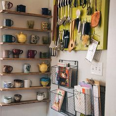 Love this little kitchen corner re-do by Manda Townsend. We've been talking about putting in hooks to hang our mugs, but our collection is growing so big. These shelves would be amazing!
