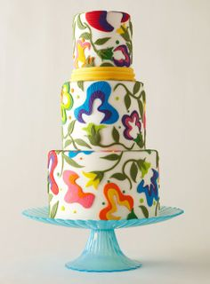 Wedding Cake. Floral Cake. White Cake with Bright Floral Design. Spring Wedding. Colorful Wedding. Bright Colors on White. Pink. Teal. Orange. Yellow. Blue. Purple. Splashes of Spring.