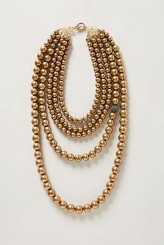 Puttin' on the glitz for the new year. Gold bead necklace.