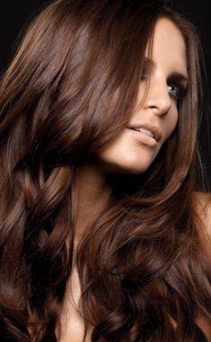 Brown wavy hair.