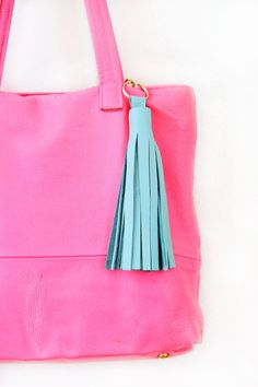 Get your spring bag ready for its seasonal debut with a #DIY leather tassel purse charm (or keychain).