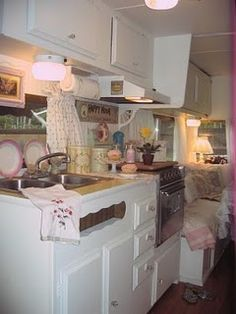 Very cute trailer kitchen that looks like it belongs in a real house , a bit girlie but the white makes it very big inside