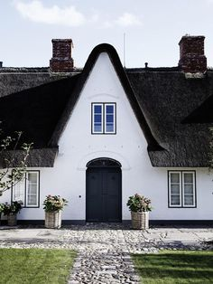 I want a thatched roof!  The inside isn't my style, but it is so very calming anyway.