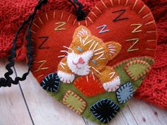 Awww - Kittys all tuckered out. Time for some zzzzzs under a comfy patchwork quilt! I used top quality 100% wool felt in terra cotta, ginger,