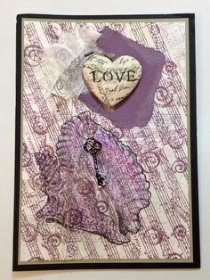 "Entered in simonsaysstampblog.com Monday Challenge ""Powder Power"" card I made for my hubby.  Used Detail  Embossing Enamel for shell, key and text on tissue covered heart.  Added messy background, curled wire, and a gold thread to embellish."