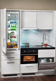tiny k, approx. layout (in a cabinet). fridge is good size, stove can be three-burner/no knobs, sink to hold a home baking sheet, note d/w under & head clearance over sink.  This is Italian; people move their entire kitchens with them.  (20180327)
