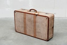 beige fabric suitcase
