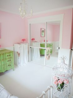 I like the barre on the mirrored closet door. Nice space saver! Oh I like the molding around the closet too!