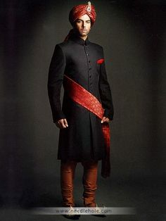 #Reception sherwani for #groom in #black color, buttons detail on front…