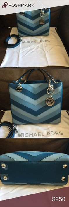 """NWT Michael Kors Chevron bag Gorgeous new MK Cynthia blue chevron bag. Double handles  6"""" drop, long strap has 18"""" drop. Silver tone hardware. Interior pockets, cell phone pocket, key chain.                   Includes white dust bag                        Dimensions 9"""" x 8"""" x 4""""          Authenticity tag displayed. Small  spot on back side see picture 6 for detail Michael Kors Bags Shoulder Bags"""