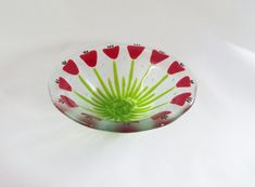 Fused Glass Bowl with deep red flowers     I made this beautiful bowl hand cutting and layering each piece into this wonderful bouquet of deep
