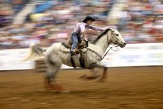 Jill Freeman races towards the finish on her horse during the barrel racing competition at the 82nd annual San Angelo Stock Show and Rodeo at the Foster Communication Coliseum Saturday evening.