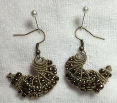 Heres a set of beautiful micromacrame earrings. Set in light copper/tan shades. This is my original creation and it is unique. Earring are 3