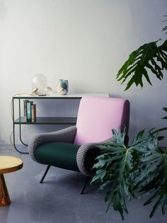 I love this fresh 'kitsch' approach to the old pink and green color combination. Using a dark forest green with the houndstooth makes this whimsical statement chair really fun! VTHome