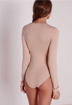 d1b30c26bc9f9 Get your basics in check with our long sleeved nude bodysuit. With a round  neck