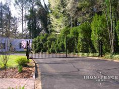 A 20ft wide decorative wrought iron arched gate to enclose a circular driveway