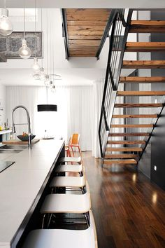 Project Image Open staircase in kitchen with stunning Long Island seating