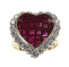 Editor's Picks from the Elizabeth Taylor Auction | Arab Women Now. A ruby, diamond and 18k gold ring. A calibre-cut ruby heart, deep purplish red, surrounded by circular-cut diamonds, mounted in 18k white and yellow gold.