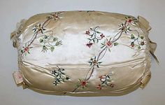 Muff  Date: ca. 1780 Culture: British Medium: silk, metallic thread Dimensions: Length: 12 in. (30.5 cm) Credit Line: Purchase, Irene Lewisohn Bequest, 1978 Accession Number: 1978.280.1, MET