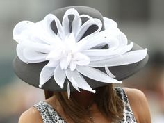 A fan looks on from the stands while she wears her derby hat during the 137th Kentucky Derby at Churchill Downs on May 7, 2011, in Louisville, Ky.