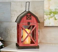 Light up your decor with some country charm. This barn-inspired lantern is complete with a flameless pillar candle to illuminate any space until the cows come home! From the Valerie Parr Hill Collection. Valerie Parr Hill, Country Charm, Pillar Candles, Light Up, Christmas Holidays, Beautiful Homes, Lanterns, Barn, Indoor