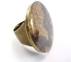 Ethnic Ultra Chic- Ring with python printed fabric and glitters.