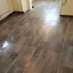 ljcfyi: Late night kitchen renovation: New tile floor. Home Depot TrafficMaster Coastal Grey vinyl tile.