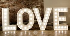 Light Up Letters - Make an impact with these beautiful illuminated letters! They provide an exciting backdrop for your wedding reception & evening party, and everyone will love having photos taken with them.  Light Up Letters provide initials for weddings, numbers for parties (21st, 40th etc.) and even a star... for whenever a giant lit up star might be called for!