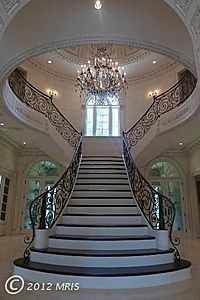 The proportions, the light, the chandelier, the shape, everything works. #Stairs