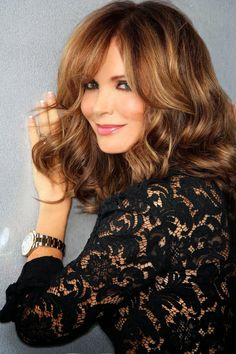 Jaclyn Smith, like Collete Colbert, she always favors one side of her face in photos.  Still beautiful though.