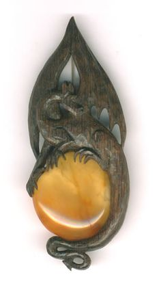 Dragon brooch made for me from bog-oak and amber by Woodland Treasures
